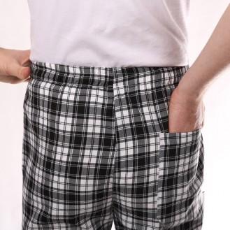 Pantaloni a quadri neri profilo indietro